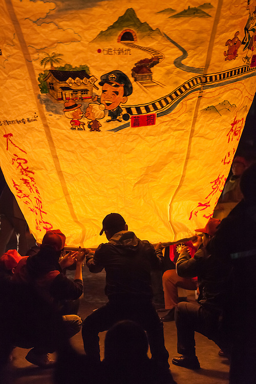 Lighting the giant lantern. Pingxi Sky Lanterns Release at Jingtong, Taiwan