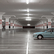 Single car in parking garage