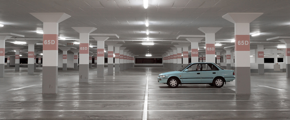 Single car in parking garage