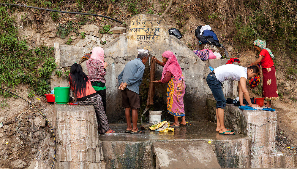 Laundry day at the public tap along the Siddhartha Highway below Tansen in Palpa, Nepal