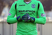 The Hibernian goalkeepers shirt and gloves showing sponsorship during the Ladbrokes Scottish Premiership match between St Mirren and Hibernian at the Paisley 2021 Stadium, St Mirren, Scotland on 27 January 2019.