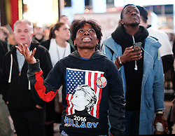 © Licensed to London News Pictures. 09/11/2016. New York City, USA. A Hilary Clinton supporter looks disappointed as she reacts to news that Donald Trump looks likely to be elected as the next president of the United States, while gathering in Times Square, New York City, on Wednesday, 9 November. Photo credit: Tolga Akmen/LNP
