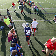 A member of the Boston Cannons runs onto the field prior to the game at Harvard Stadium on May 17, 2014 in Boston, Massachuttes. (Photo by Elan Kawesch)
