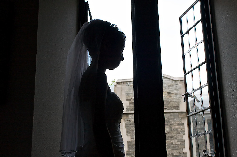 The beautiful bride enjoys a quiet moment.