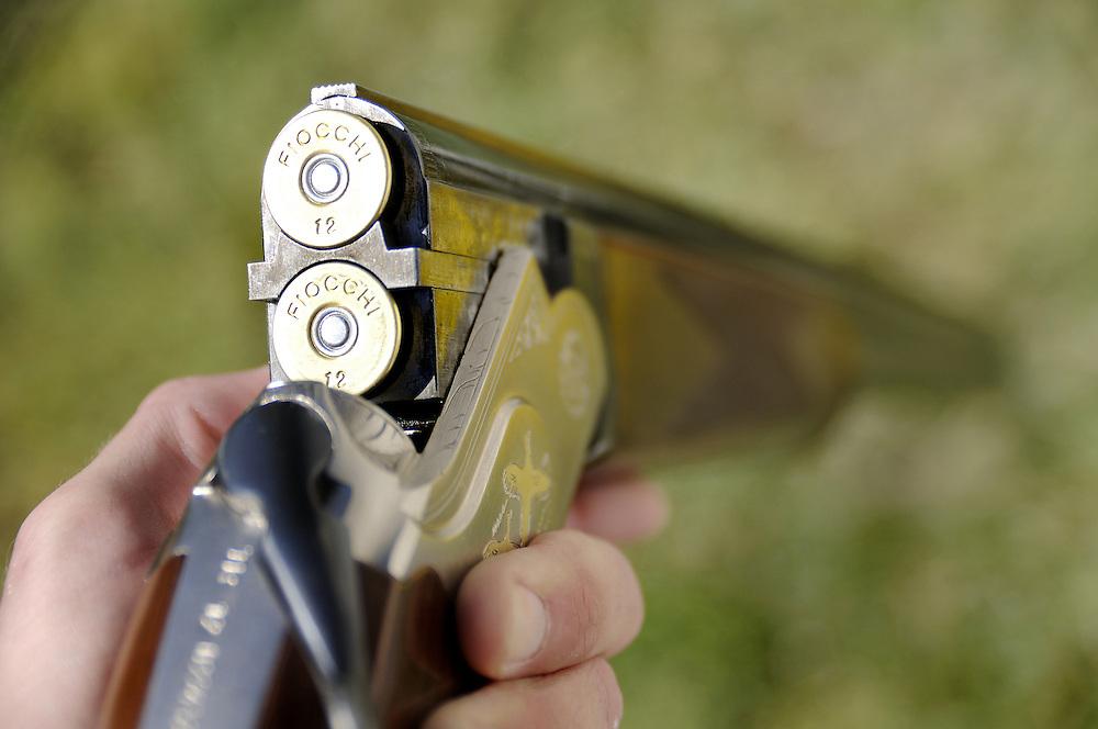 Over-under shotgun loaded for hunt.