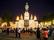 24 NOVEMBER 2018 - BANGKOK, THAILAND:  People wait to get into the Red Cross Fair in front of the statue of Thai King Rama VI in Lumpini Park. The Red Cross Fair is a fund raiser and an annual event in Bangkok that draws thousands of attendees every night of its nine day run. The fair features games of chance, a midway with rides, handicrafts and food. This is the first year the fair has been in Lumpini Park. Previously it had been held in the Dusit section of Bangkok. The 2018 Fair marks 125 years of service for the Red Cross in Thailand.   PHOTO BY JACK KURTZ