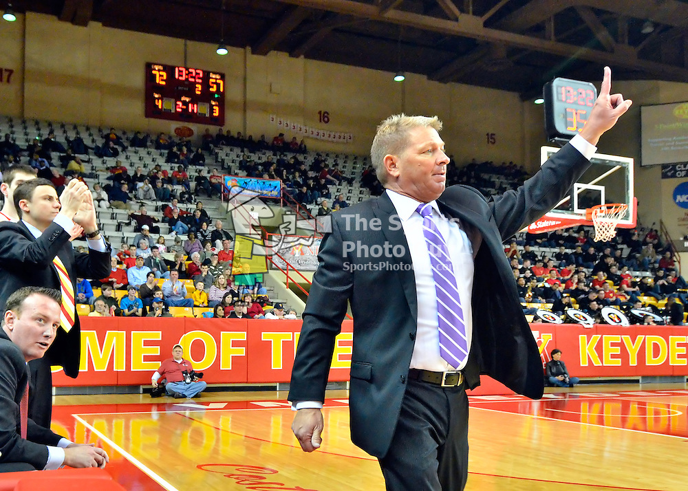 NCAA Men's Basketball: VMI head coach Duggar Baucom calls out a play in the second half of VMI's 94-80 win over Longwood on Saturday in Lexington.  With the win, Baucom became VMI's all-time winningest coach with 117 victories.
