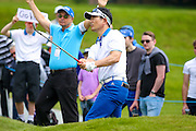 Korean golf professional Y E Yang  chips onto the green during the BMW PGA Championship at the Wentworth Club, Virginia Water, United Kingdom on 28 May 2016. Photo by Simon Davies.