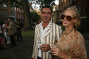 Carol and John F, The Big Splash! Summer Party, The Residents' Society Of Mayfair & St James's Summer Party, Mount Street Gardens, London, W1, 12 June 2006. ONE TIME USE ONLY - DO NOT ARCHIVE  © Copyright Photograph by Dafydd Jones 66 Stockwell Park Rd. London SW9 0DA Tel 020 7733 0108 www.dafjones.com