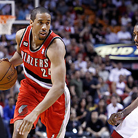 08 March 2011: Portland Trail Blazers point guard Andre Miller (24) drives past Miami Heat point guard Mario Chalmers (15) during the Portland Trail Blazers 105-96 victory over the Miami Heat at the AmericanAirlines Arena, Miami, Florida, USA.