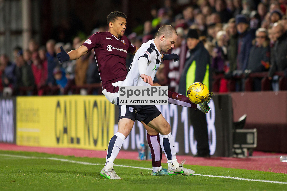 Osman Sow of Hearts (L) and James McPake of Dundee (R) battle for the ball during the Ladbrokes Scottish Premiership match between Heart of Midlothian FC and Dundee FC at Tynecastle Stadium on November 21, 2015 in Edinburgh, Scotland. Photo by Jonathan Faulds/SportPix