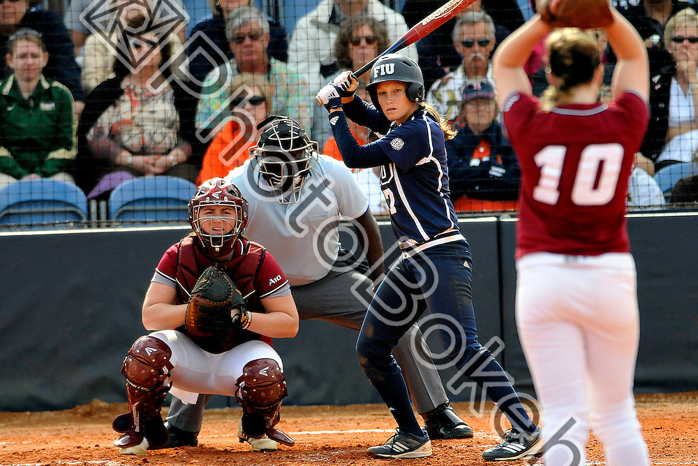 2012 February 11 - FIU's Erika Arcuri (12) competing in the second day of the COMBAT Classic at the FIU Softball Complex, Miami, Florida. (Photo by: www.photobokeh.com / Alex J. Hernandez) 1/1600 f/4.8 ISO800 1050mm