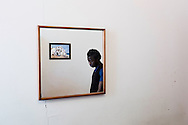Na poli, Italia - 9 febbraio 2012. Djbril Falkey Fatah, 18 anni, nigeriano, sbarcato lo scorso maggio sull'isola di Lampedusa ritratto nella stanza di un albergo di Napoli nella quale vive. Da mesi e in attesa di ricevere lo status di rifugiato..Ph. Roberto Salomone Ag. Controluce.ITALY - Djbril Falkey Fatah, 18, nigerian, portrayed in the hotel rome he lives in, in Naples on February 9, 2012. Djbril arrived on the italian island of Lampedusa in May 2011 and is still waiting to receive the refugee status.