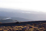 June 26-30 - Pikes Peak Colorado. A contender in the open wheel division runs up the hill during wednesday practice.