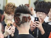 """TAIYUAN, CHINA -  CHINA OUT<br /> <br /> Crazy hairstyle's<br /> <br />  A barber designs a """"Dragon"""" hairstyle for the Dragon Raises Its Head festival in Taiyuan, Shanxi Province of China. The Dragon Raises Its Head falls on the 2nd day of the second lunar month in Chinese calendar.<br /> ©Exclusivepix"""