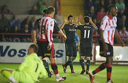 EXETER, ENGLAND - Wednesday, August 24, 2011: Liverpool's Luis Alberto Suarez Diaz celebrates the second goal against Exeter City scored by Maximiliano Ruben Maxi Rodriguez during the Football League Cup 2nd Round match at St James Park. (Pic by David Rawcliffe/Propaganda)