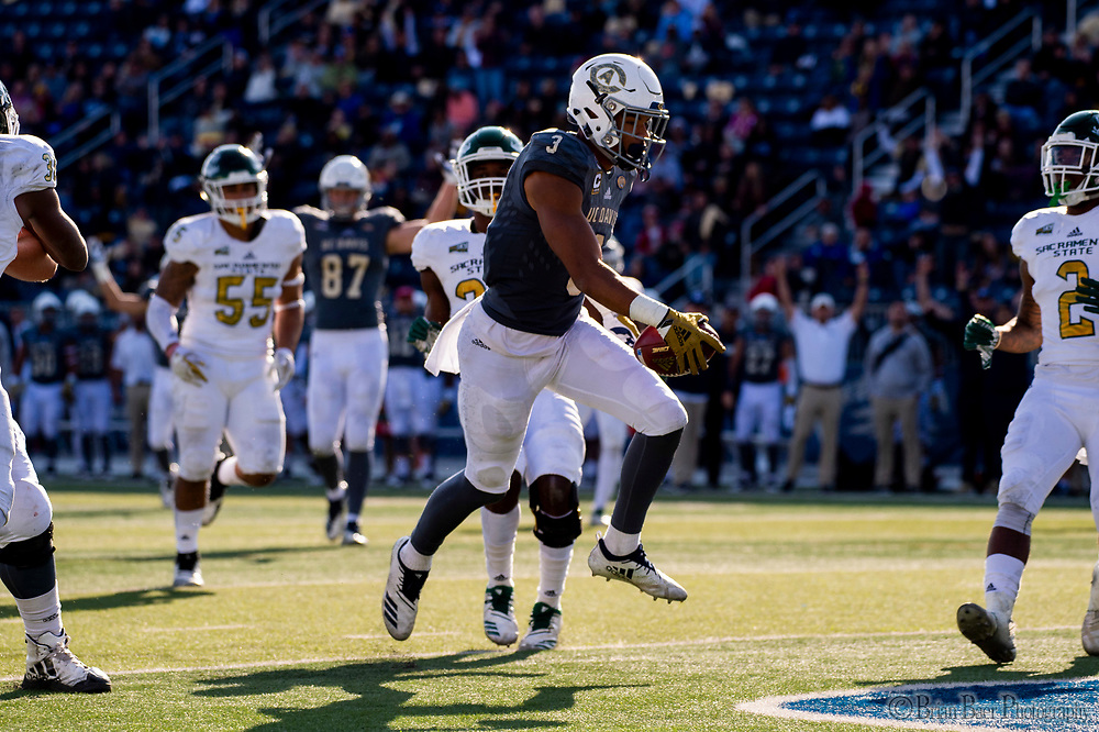 UC Davis Aggies wide receiver Keelan Doss (3), runs with the ball after his catch for a touchdown to lead 35-10 during the second quarter during the 65th Causeway Classic football game between the Sacramento State Hornets and the UC Davis Aggies at Mackay Stadium at  the University of Reno, Saturday Nov 17, 2018. The game was moved there due to the bad air quality in Sacramento due to the Camp Fire.