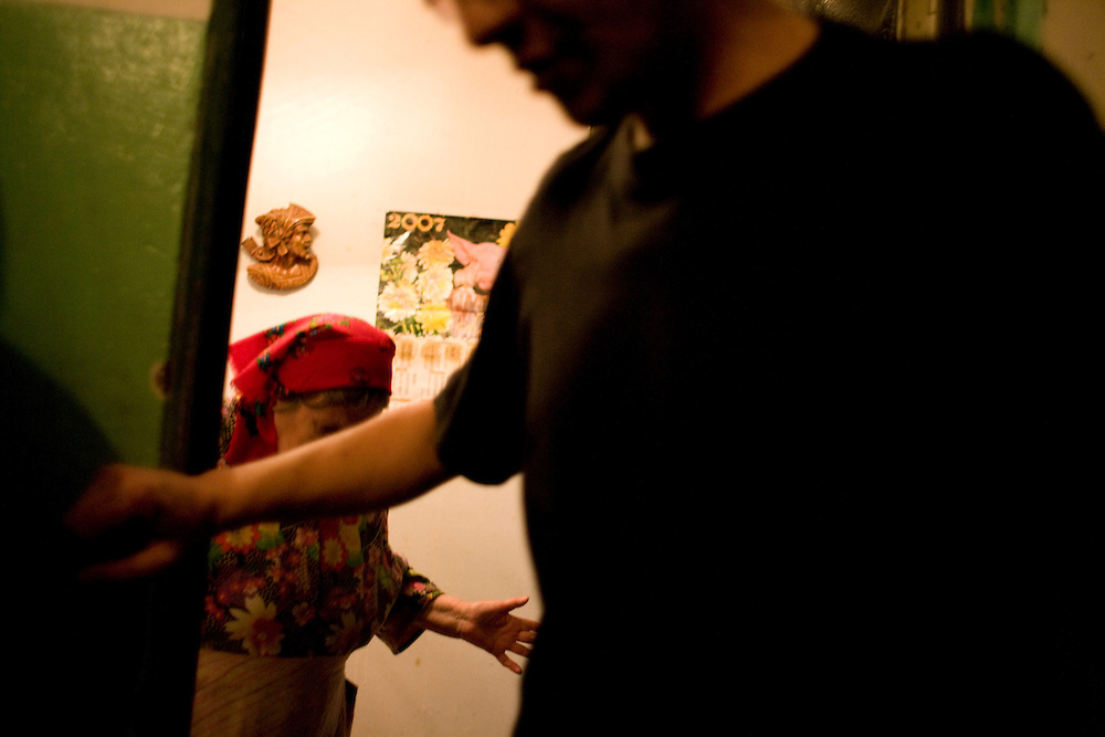 Vadim Simashov, a heroin user on and off for 14 years, with his mother in the apartment he shares with his parents in Kazan, Russia, on Saturday, September 22, 2007.