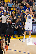 Golden State Warriors guard Klay Thompson (11) shoots a three pointer over Houston Rockets guard James Harden (13) at Oracle Arena in Oakland, Calif., on March 31, 2017. (Stan Olszewski/Special to S.F. Examiner)