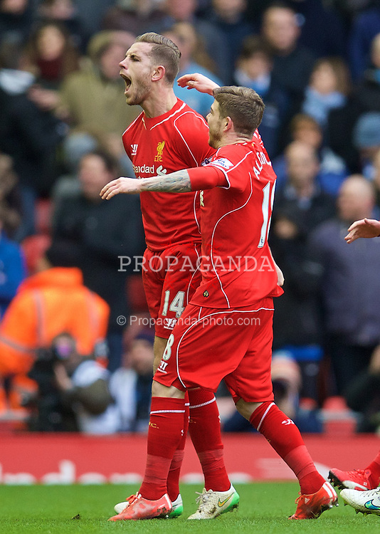 LIVERPOOL, ENGLAND - Sunday, March 1, 2015: Liverpool's captain Jordan Henderson celebrates scoring the first goal against Manchester City during the Premier League match at Anfield. (Pic by David Rawcliffe/Propaganda)