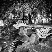 Rome - Gardens in front of the Diocletian Thermal Baths. Here the kids are sleeping mostly Egyptians mahghrebini minors, under the tree, on top of the cartons and two blankets. All around waste of all kinds and the smell of excrement. Kids sleep on the ground, steal, prostitute themselves. Invisible. Behind A 400 meters there is Termini Station and across the street passing tourists, unaware, on a visit the Diocletian Thermal Baths