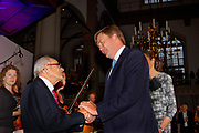 "Koning Willem-Alexander is in de Amsterdamse Westerkerk aanwezig bij de première van de concerttournee 'Er reed een trein naar Sobibor' <br /> <br /> King Willem-Alexander attends the premiere of the concert tour in Amsterdam Westerkerk ""There rode a train to Sobibor""<br /> <br /> Op de foto / On the photo:  Koning Willem-Alexander en de 93-jarige Jules Schelvis, overlevende van vernietigingskamp Sobibor<br /> <br /> King Willem-Alexander and 93-year-old Jules Haddock, survivor of the Sobibor extermination camp"