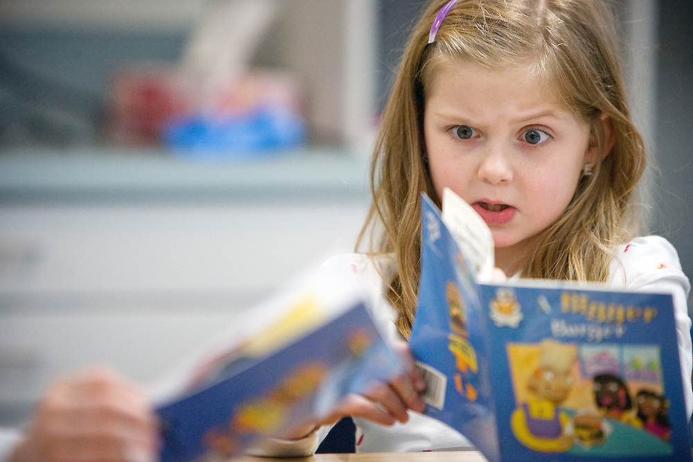 "JEROME A. POLLOS/Press..Emma Bristow, a first grade student at Sunnyside Elementary in Kellogg, gets involved in the book ""A Bigger Burger"" her class was reading in preparation for the upcoming ISAT tests. ""She really gets into her reading,"" her reading instructor said."