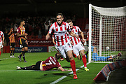 Ben Tozer scores CTFC's 3rd goal and runs off to celebrate  during the EFL Sky Bet League 2 match between Cheltenham Town and Bradford City at Jonny Rocks Stadium, Cheltenham, England on 17 September 2019.