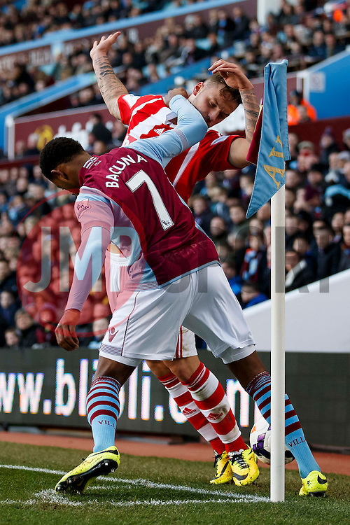 Stoke Forward Marko Arnautovic (AUT) is knocked in the head by Aston Villa Forward Leandro Bacuna (NED) - Photo mandatory by-line: Rogan Thomson/JMP - 07966 386802 - 23/03/2014 - SPORT - FOOTBALL - Villa Park, Birmingham - Aston Villa v Stoke City - Barclays Premier League.