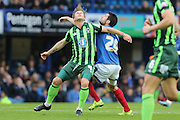 Dannie Bulman of AFC Wimbledon, Danny Hollands battle during the Sky Bet League 2 match between Portsmouth and AFC Wimbledon at Fratton Park, Portsmouth, England on 15 November 2015. Photo by Stuart Butcher.