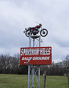 An old Honda tops the sign at the Spavinaw HIlls motorcycle rally campground.