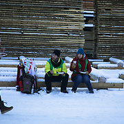 The second day of the Strike WEF march on Davos, 20th of January 2020, Switzerland. Lunch break. Lunch in the snow. Food for 500 people, including sweet donuts and hot drinks is cooked out door by a cooking collective, all vegan and tasty. The march started in Schiers and walked the 24 kilomers to Klosters.  The aim is to finish in Davos with a public meeting in the town on the day the WEF begins. The march is a three day protest against the World Economic Forum meeting in Davos. The activists want climate justice and think that The WEF is for the world's richest and political elite only.
