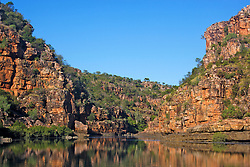 Stunning red sandstone cliffs are reflected the Sale River.
