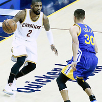 08 June 2016: Golden State Warriors guard Stephen Curry (30) defends on Cleveland Cavaliers guard Kyrie Irving (2) during the Cleveland Cavaliers 120-90 victory over the Golden State Warriors, during Game Three of the 2016 NBA Finals at the Quicken Loans Arena, Cleveland, Ohio, USA.