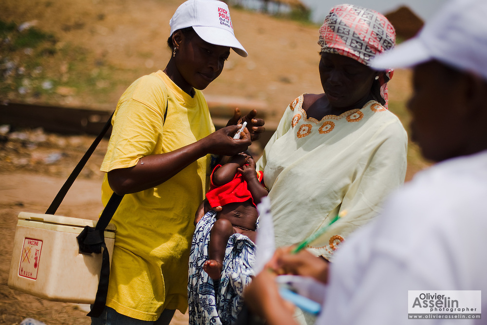 A health worker vaccinates a child against polio in the town of Makango, northern Ghana on Thursday March 26, 2009.
