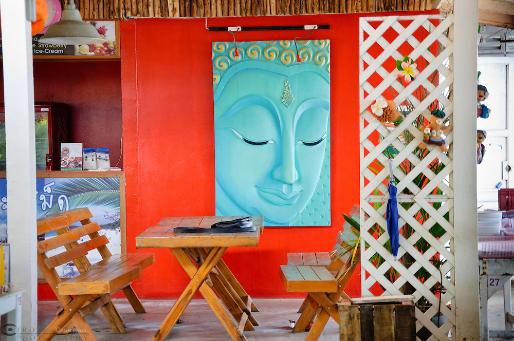 Colorful painting of  Buddha hanging on the wall, Thailand.