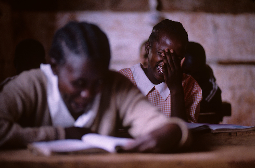 Africa, Kenya, Ruira, Portrait of young boy studying in classroom at Oakland Primary School on Socfinaf coffee plantation