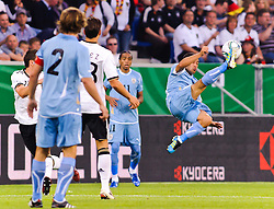 29.05.2011, Rhein-Neckar-Arena, Sinsheim, GER, LS FSP, Deutschland (GER) vs Uruguay (UY), im Bild Walter Gargano (R) of Uruguay jumps for the ball during the Football Friendly Ship betweem Germany and Uruguay  for the Rhein-Neckar-Arena in Sinsheim, Germany, 2011/05/29, EXPA Pictures © 2011, PhotoCredit: EXPA/ nph/  Roth       ****** out of GER / SWE / CRO  / BEL ******