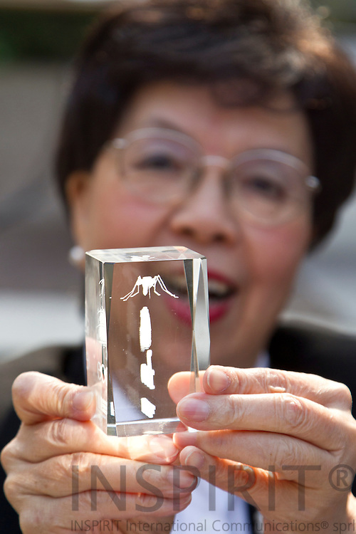 Dr. Margaret Chan, Director-General for WHO, with a special gift from ECDC showing an mosquito inside a sculpture given to her at the World Health Organization and European Commission Summit in Brussels Friday 25 March 2011. PHOTO: ERIK LUNTANG / INSPIRIT Photo.