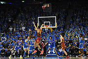 Feb 28, 2019; Los Angeles, CA, USA; Southern California Trojans forward Bennie Boatwright (25) is defended by UCLA Bruins guard David Singleton (34) on a 3-point shot attempt at the end of regulation at Pauley Pavilion. UCLA defeated USC 93-88 in overtime.
