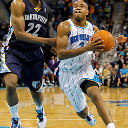 December 21, 2011; New Orleans, LA, USA; New Orleans Hornets point guard Jarrett Jack (2) drives past Memphis Grizzlies small forward Rudy Gay (22) during a preseason game at the New Orleans Arena.   Mandatory Credit: Derick E. Hingle-US PRESSWIRE