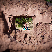 Looking at Shannon through a window of an abandoned farm house at Twyfelfontein, Namibia.