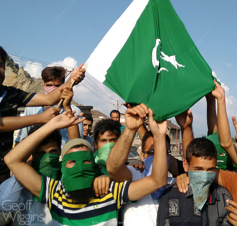 Kashmiri protesters waving Pakistani flags manning roadblock sealing off Srinagar City from the outside world during civil unrest 2016