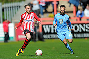 Exeter City's Jake Taylor and Morecambe's Lee Molyneux during the Sky Bet League 2 match between Exeter City and Morecambe at St James' Park, Exeter, England on 30 April 2016. Photo by Graham Hunt.