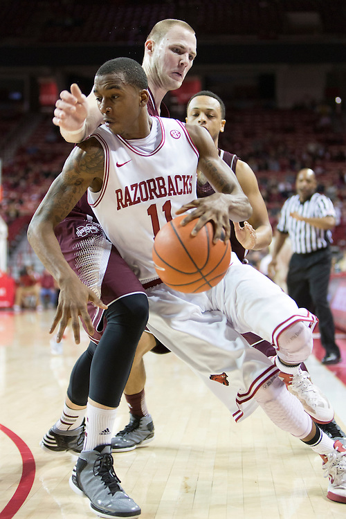 FAYETTEVILLE, AR - JANUARY 23:  BJ Young #11 of the Arkansas Razorbacks drives to the basket around Colin Borchert #3 of the Mississippi State Bulldogs at Bud Walton Arena on January 23, 2013 in Fayetteville, Arkansas. The Razorbacks defeated the Bulldogs 96-70.  (Photo by Wesley Hitt/Getty Images) *** Local Caption *** BJ Young; Colin Borchert