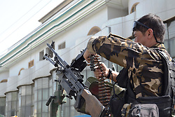KANDAHAR, Sept. 12, 2016 (Xinhua) -- An Afghan security force member prepares his weapon near the site of a militants' attack in Kandahar, Afghanistan, Sept. 12, 2016. Two militants attacked a hospital in Kandahar city in southern Afghanistan on Monday, and the following gun battle with security forces killed three people including two attackers and a patient, deputy provincial police chief Rahmatullah Atrafi said. (Xinhua/Manan Arghand).****Authorized by ytfs* (Credit Image: © Manan Arghand/Xinhua via ZUMA Wire)