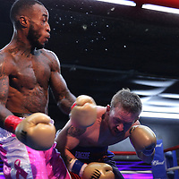 LeAnthony Fleming fights against Randy Hedderick during the Mad Integrity Fight sports boxing match at the Florida Orange Event Center in Lakeland, Florida on Saturday October 10, 2015. Photo: Alex Menendez