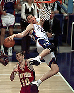 1997 Big 12 basketball tournament--- Kansas' Raef LaFrentz (45), top, hangs on the rim. At bottom is Iowa State's Jacy Holloway (10).