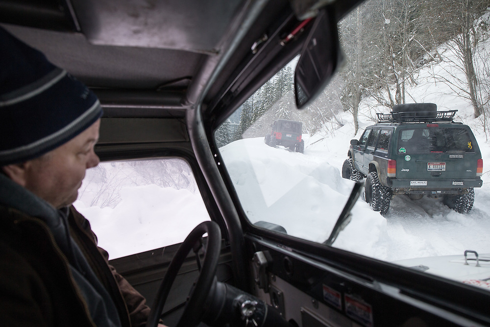 GABE GREEN/Press<br /> <br /> Mark Tihonovich drives with a convoy of Jeeps on a trail near Mullan, Idaho Saturday. Two of the vehicles carried United States veterans for an event put on by the North Idaho Trailblazers that aimed to show vets a good time and break up the slow pace of the winter months.