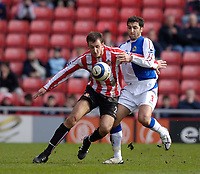 Photo: Jed Wee.<br />Sunderland v Blackburn Rovers. The Barclays Premiership. 25/03/2006.<br /><br />Sunderland's Chris Brown (L) tries to hold off Blackburn's Zurab Khizanishvilli.